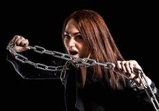 Beautiful young woman with chains Royalty Free Stock Photos