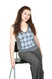 Beautiful young woman on chair Royalty Free Stock Photography