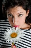 Beautiful young woman with chamomile in hand Stock Photography