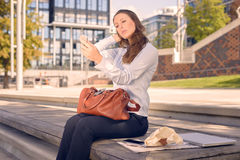 Beautiful young woman checking her appearance Royalty Free Stock Photos