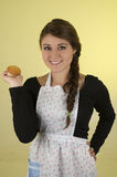 Beautiful young woman chef cook baker wearing Stock Images