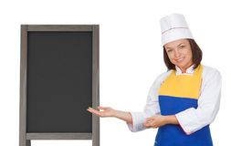 Beautiful Young Woman Chef near Blank Wooden Menu Blackboard Out. Door Display on a white background Royalty Free Stock Photos