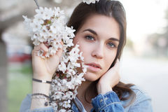 Beautiful young woman with cherry flower Royalty Free Stock Photo