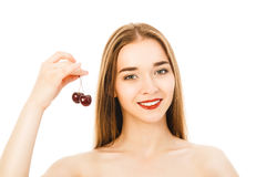 Beautiful young woman with cherry isolated. Beautiful woman with cherry isolated Stock Photography