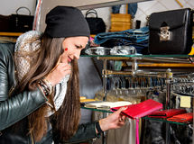 Beautiful young woman choosing leather purse Royalty Free Stock Image