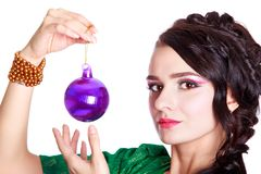 Beautiful young woman with a Christmas bauble Royalty Free Stock Photo