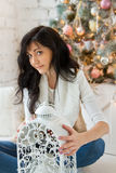 Beautiful young woman with Christmas candle Royalty Free Stock Photo