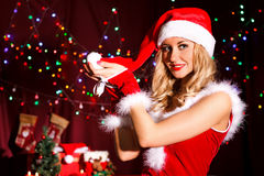 Beautiful young woman in a Christmas clothes Royalty Free Stock Photos