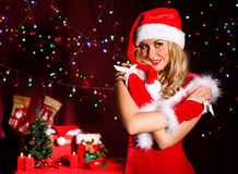 Beautiful young woman in a Christmas clothes Stock Photos