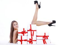 Beautiful young woman in Christmas costume lying near the pile. Of Christmas gifts. photo with copy space Stock Photo