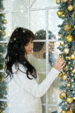 Beautiful young woman in Christmas evening Royalty Free Stock Photos