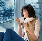 Beautiful young woman in Christmas evening Stock Images