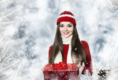 Beautiful young woman with christmas gift royalty free stock images