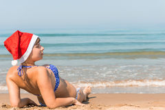 Beautiful young woman in Christmas hat Stock Photos