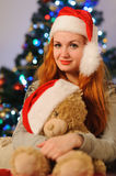 Beautiful young woman during christmas holidays royalty free stock images