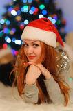 Beautiful young woman during christmas holidays royalty free stock photography