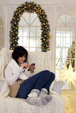 Beautiful young woman in Christmas interior Royalty Free Stock Images