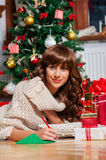 Beautiful young woman at christmas Stock Images
