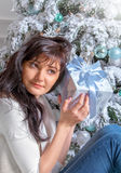 Beautiful young woman with Christmas present Stock Photography