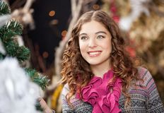 Beautiful Young Woman In Christmas Store Stock Images