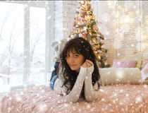 Beautiful young woman and Christmas tree Stock Photos