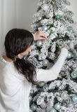 Beautiful young woman and Christmas tree Royalty Free Stock Photography