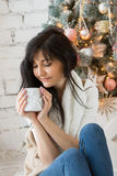 Beautiful young woman in Christmas tree Royalty Free Stock Photography