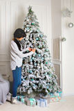 Beautiful young woman in Christmas tree Stock Photos