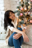 Beautiful young woman in Christmas tree Stock Photography
