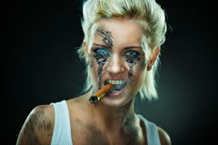 Beautiful young woman with cigar in mouth Royalty Free Stock Photos