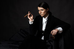 Beautiful young woman with cigare Royalty Free Stock Photography