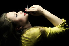Beautiful young woman with a cigarette in a hand Royalty Free Stock Images