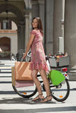 Beautiful young woman in the city with bike Stock Photos