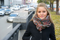 Beautiful young woman in the city street Royalty Free Stock Photography