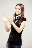 Beautiful young woman clapping and smiling Royalty Free Stock Photos