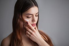 Beautiful Young Woman with Clean Fresh Skin. Close up Portrait. Royalty Free Stock Image