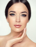 Beautiful young woman with clean fresh skin. Cosmetic and cosmetology. Royalty Free Stock Images