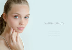Beautiful young woman with clean fresh skin. On light background Royalty Free Stock Photos