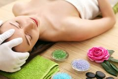 Beautiful Young Woman with Clean Fresh Skin touch own face . Fac Stock Photos