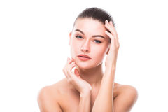 Beautiful Young Woman with Clean Fresh Skin touch own face . Facial treatment . stock photos