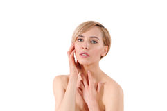 Beautiful young woman with clean fresh skin touch own face Royalty Free Stock Images