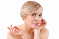 Beautiful young woman with clean fresh skin touch own face Royalty Free Stock Photography