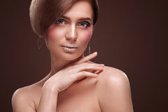 Beautiful Young Woman with Clean Fresh Skin touch own face . Facial treatment . Cosmetology , beauty and spa . Isolated Royalty Free Stock Photography