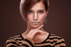 Beautiful Young Woman with Clean Fresh Skin touch own face . Facial treatment . Cosmetology , beauty and spa . Isolated Stock Photos
