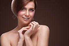 Beautiful Young Woman with Clean Fresh Skin touch own face . Facial treatment . Cosmetology , beauty and spa . Isolated Stock Image