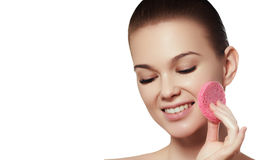 Beautiful young woman with clean fresh skin touch own face. Facial treatment royalty free stock image