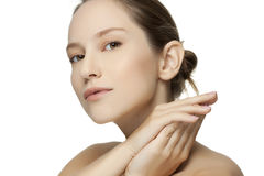 Beautiful young woman with clean skin of the face. Stock Photography