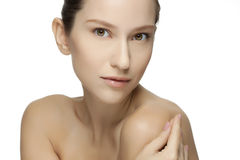 Beautiful young woman with clean skin of the face. Stock Photo