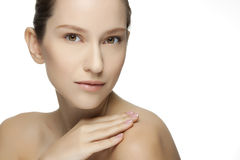 Beautiful young woman with clean skin of the face. Stock Image