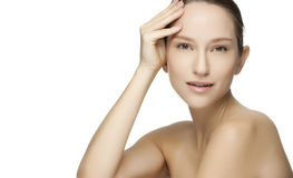 Beautiful young woman with clean skin of the face. Stock Photos